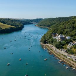 Aerial view of Golant, the river Fowey and the Cormorant property development